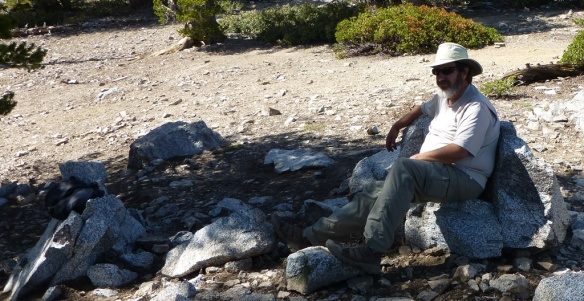 """Kyle Kuns enjoying the view from his """"rocky chair"""". Photo by Debbie Kuns."""