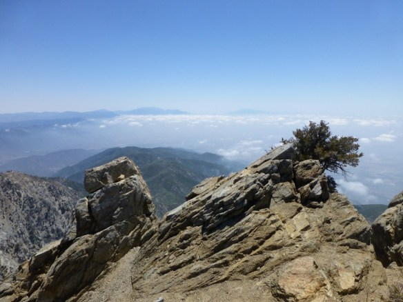 View toward Mt. San Gorgonio and Mt. San Jacinto from Cucamonga Peak with clouds breaking up.