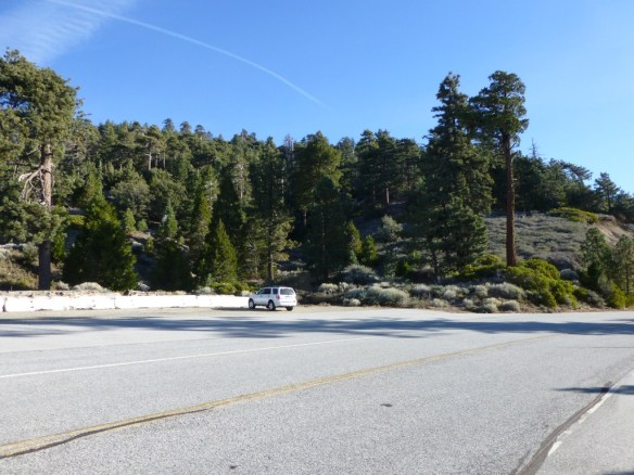 View of Pacific Crest Trailhead parking area heading east (toward Islip Saddle) along Angeles Crest Highway.