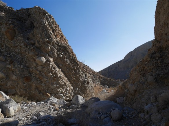 Sedimentary walls appear further down Storm Trees Canyon as it also widens.