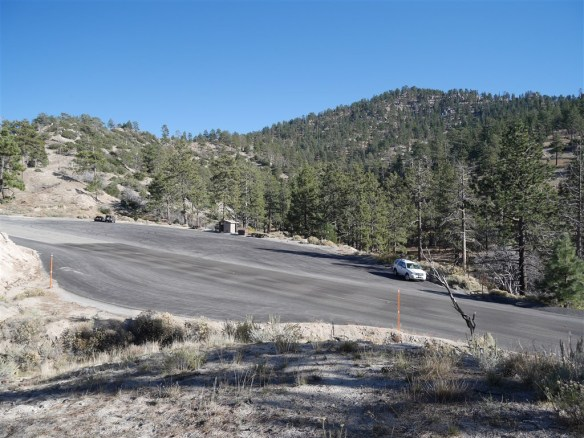 View toward parking area near mile marker 54.10 on Angeles Crest Highway from the Pacific Crest Trail. Mt. Waterman is in the background.