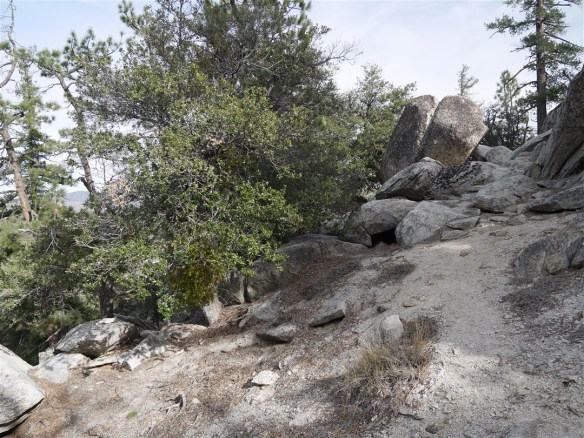 At this point it appears the trail goes over the boulders. It actually continues down on the left below the boulders.