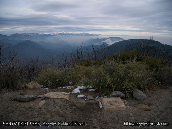 View from San Gabriel Peak with Mt. Wilson close by on the right and a snow capped Mt. Baldy in the distance.